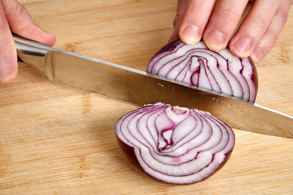 stainless steel knife and sliced onion