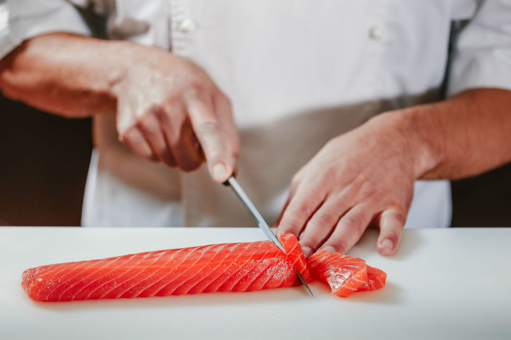 chef slicing fish