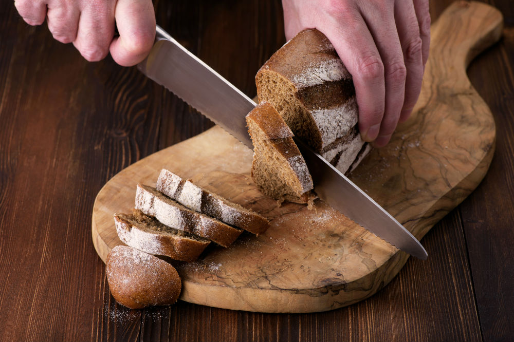 Slicing bread with knife
