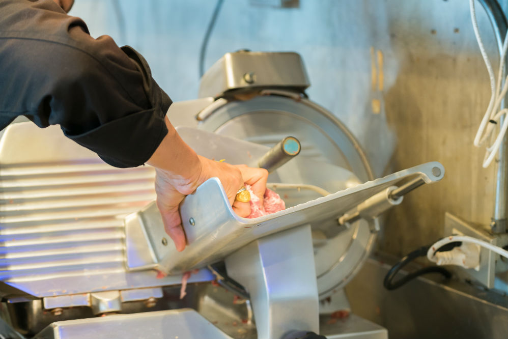Man using Meat Slicer